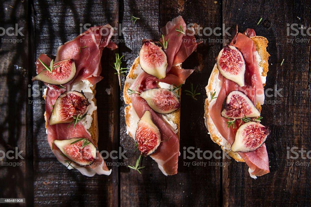 Figs and prosciutto bruschetta stock photo