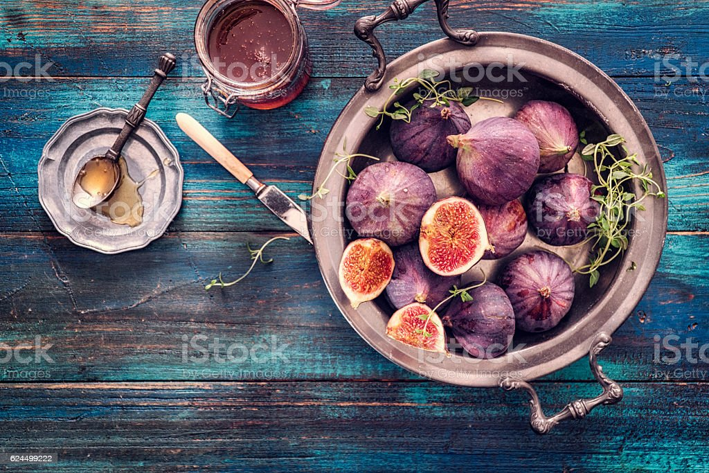 Figs and Sweet Honey on Wooden Background stock photo