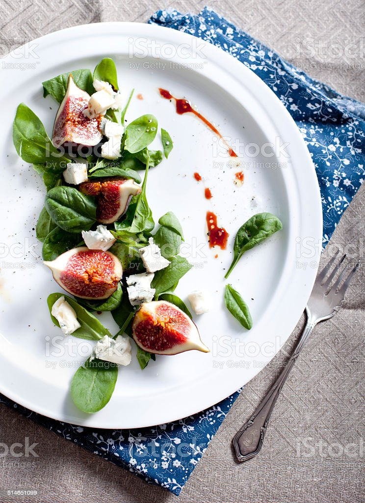 Figs, gorgonzola and spinach salad stock photo