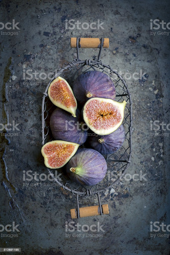Figs in a basket on rustic metal background stock photo