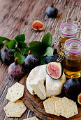 figs with cheese and honey , selective focus