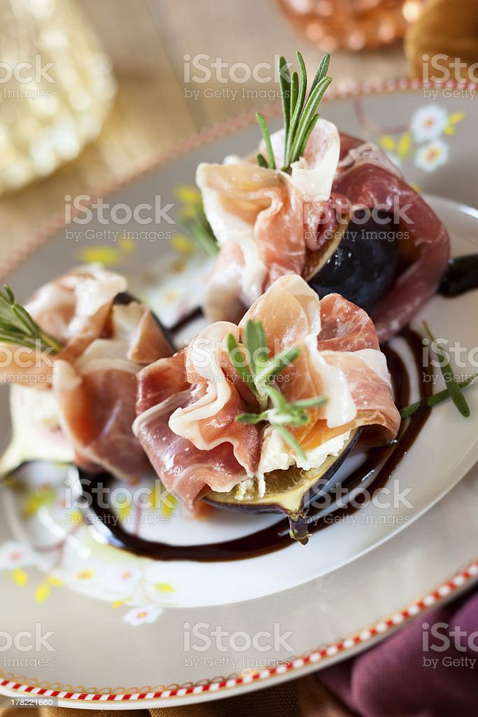 Figs with Prosciutto, Goat Cheese and Rosemary royalty-free stock photo