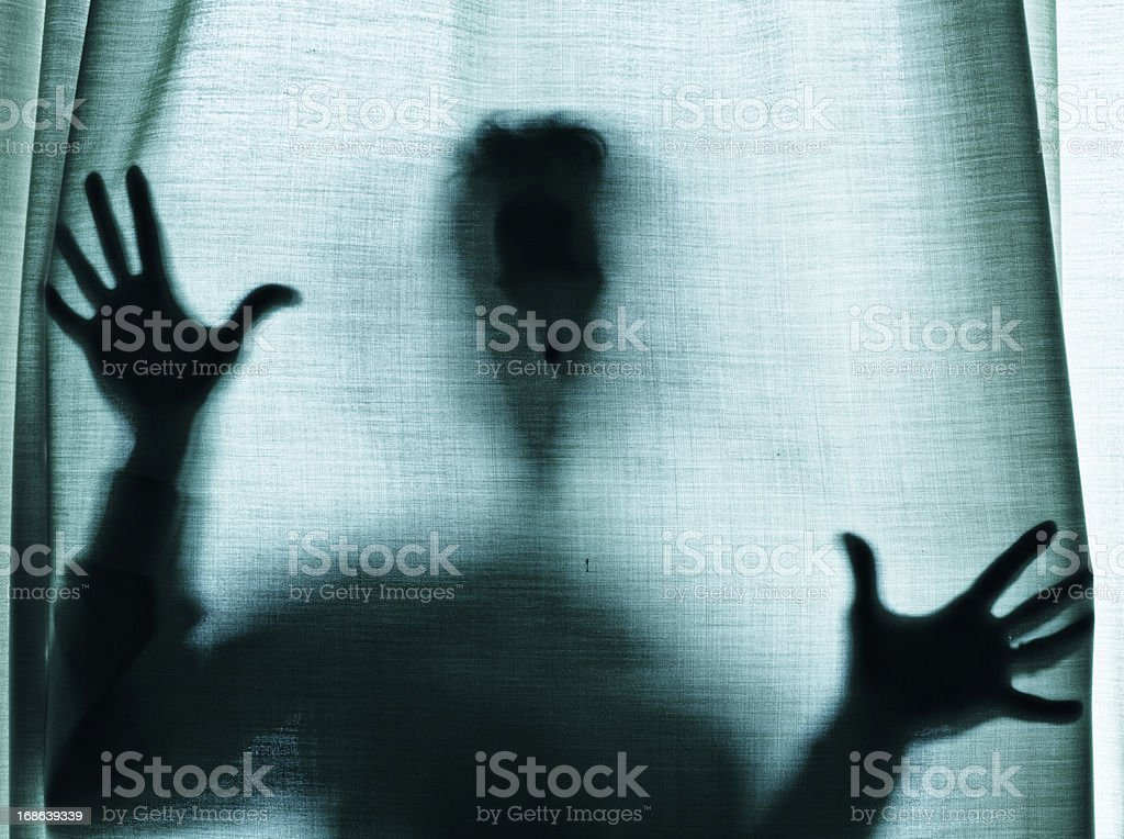 Figure behind a curtain royalty-free stock photo
