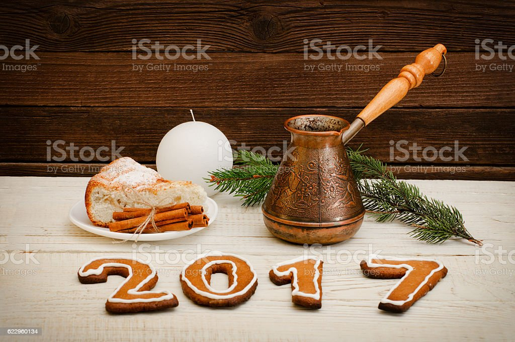 Figure in 2017 of gingerbread, spruce branch, candle pots stock photo