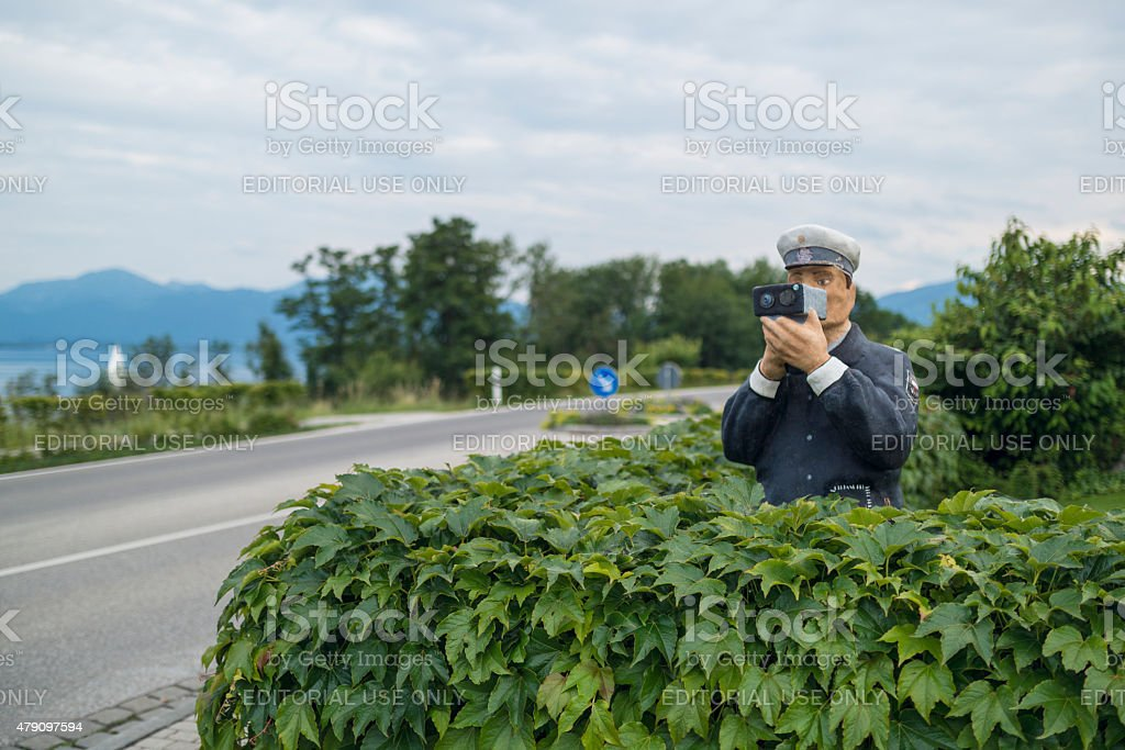 figure of a policeman with a radar stock photo