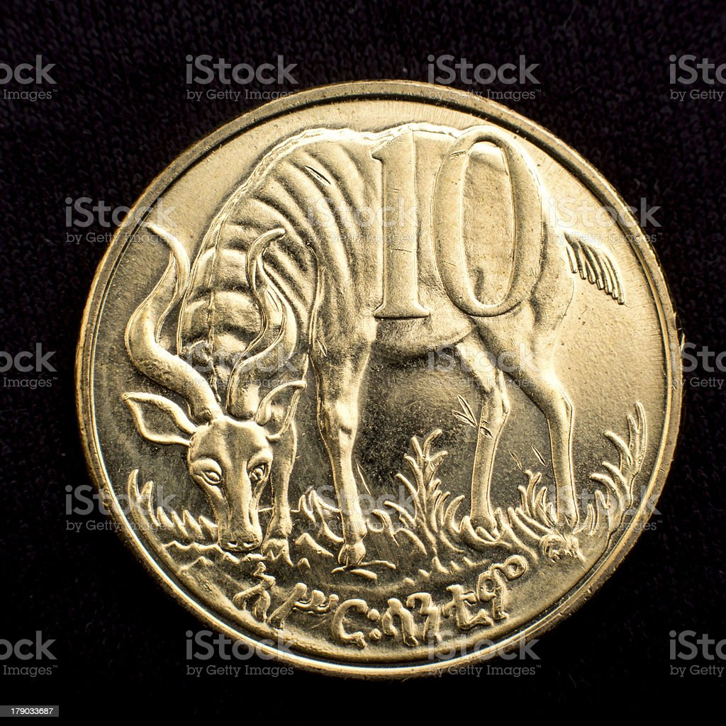 Figure of an antelope on a coin royalty-free stock photo