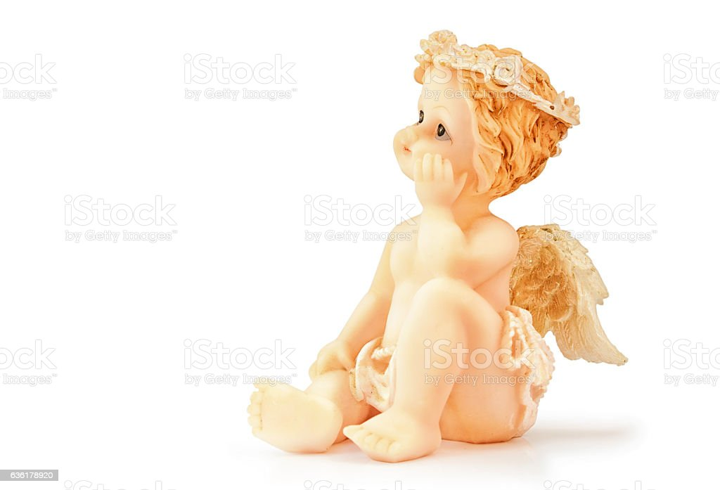 Figure of the sitting angel on a white background. stock photo