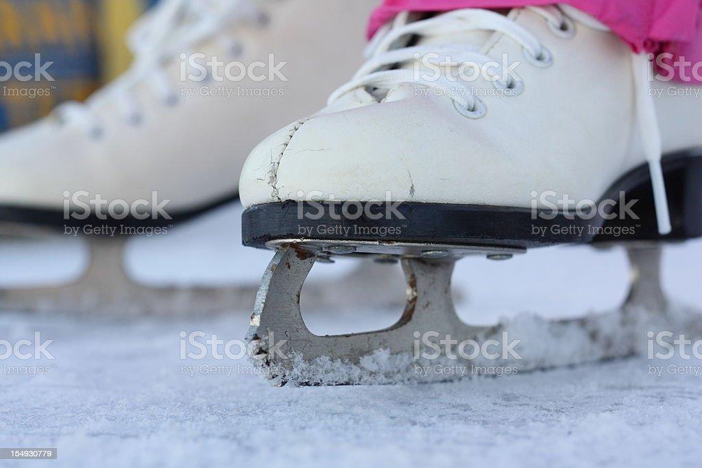Figure Skates on Ice royalty-free stock photo