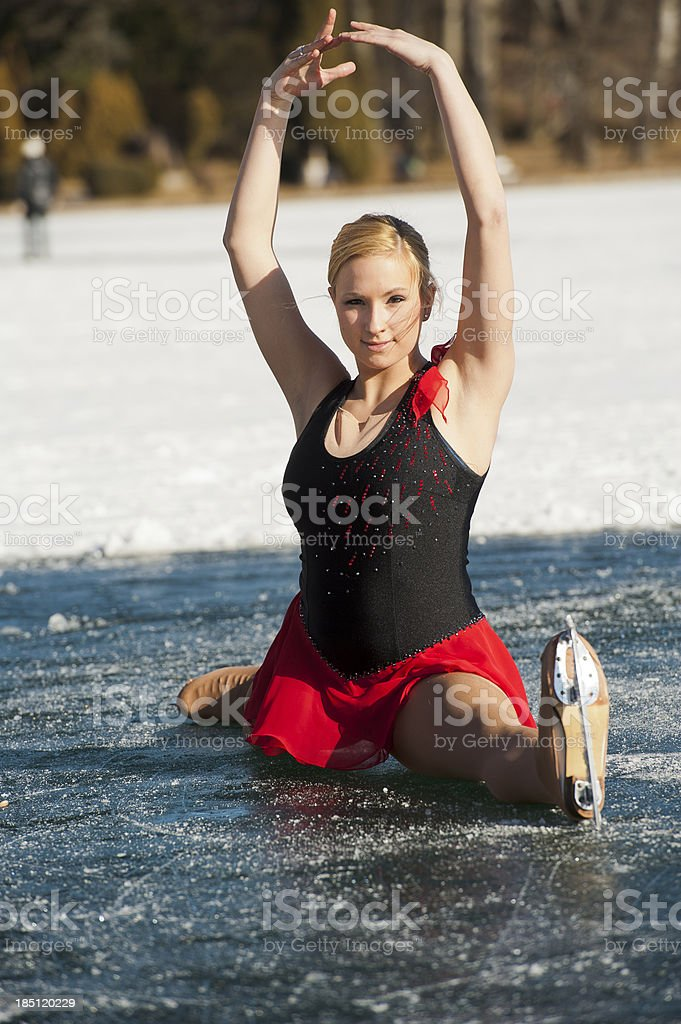 Figure skating girl on natural ice rink stock photo