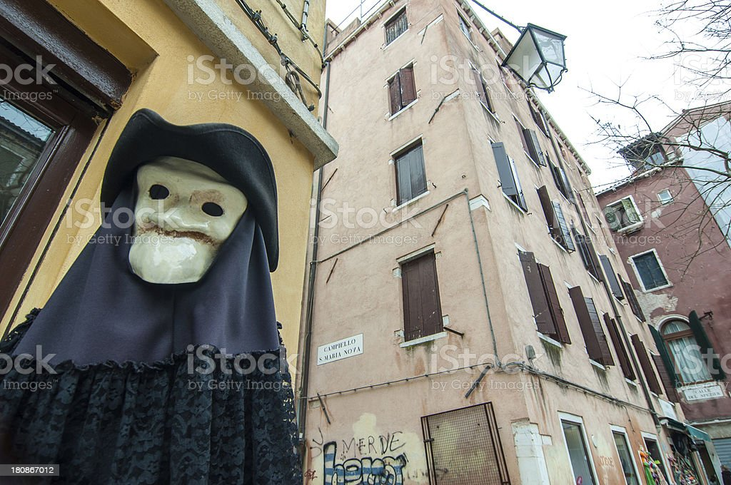 Figure with plague mask and costume in Venice royalty-free stock photo