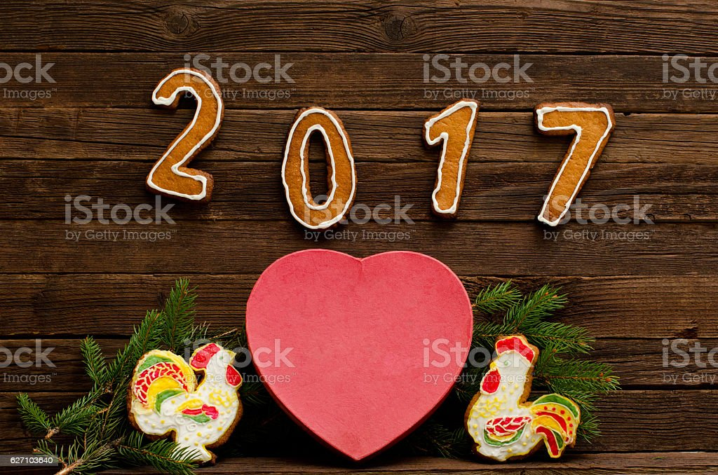 Figures 2017, big heart, two gingerbread rooster stock photo