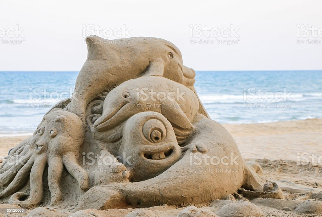 Figures from the sand stock photo