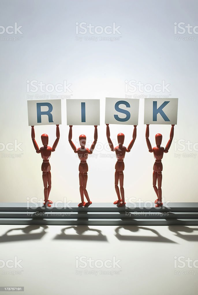 Figures holding risk sign royalty-free stock photo