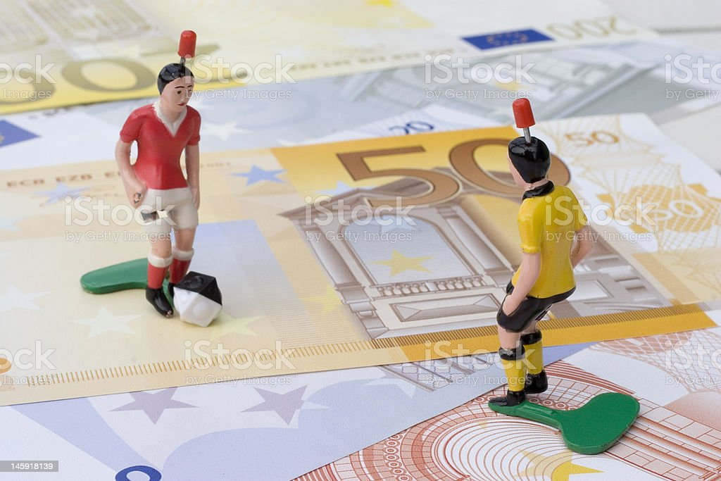 Figures of football players on banknotes royalty-free stock photo