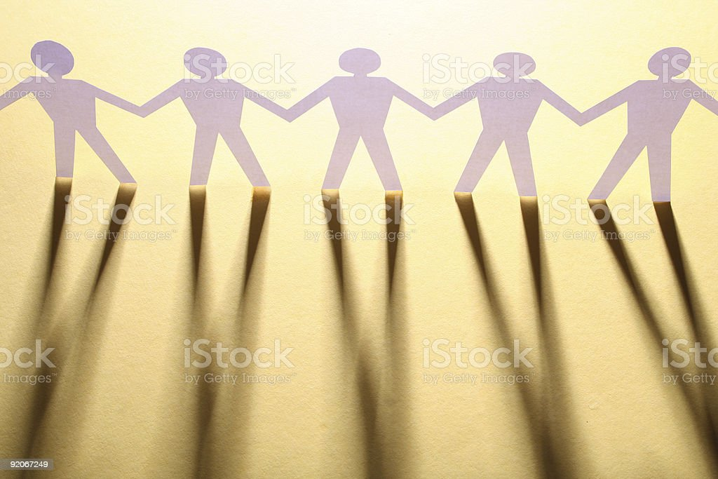 figures of man in paper on yellow stock photo