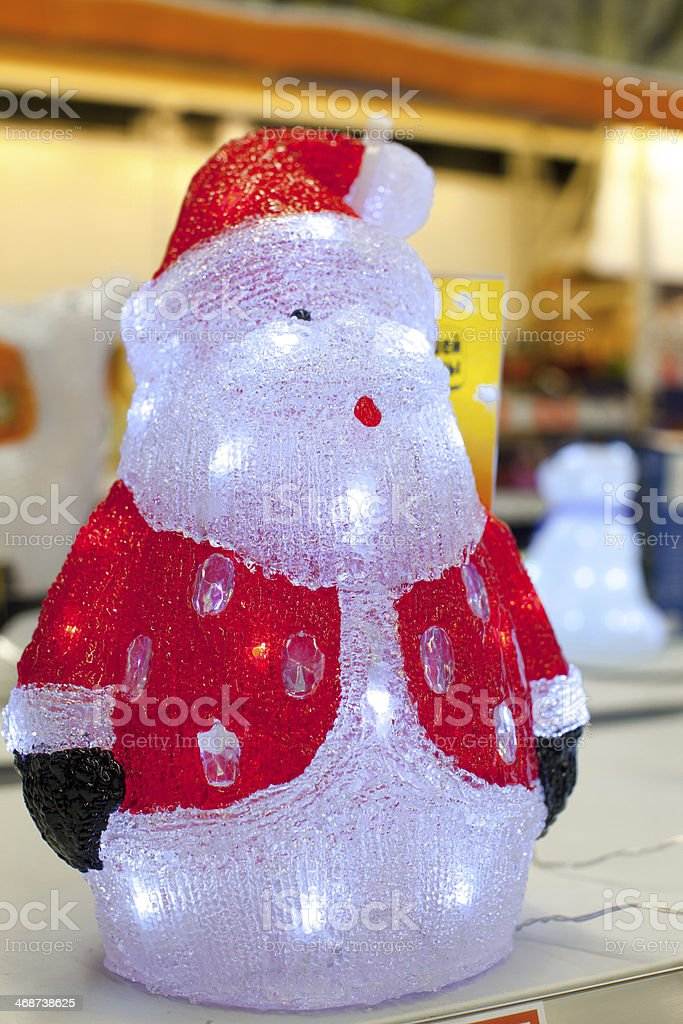 Figures of Santa with light bulbs inside in supermarket royalty-free stock photo