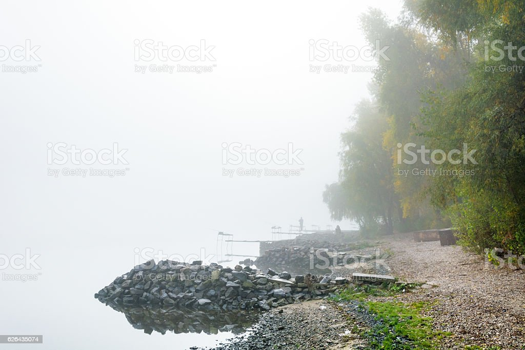 figures of the fishermen in the fog stock photo