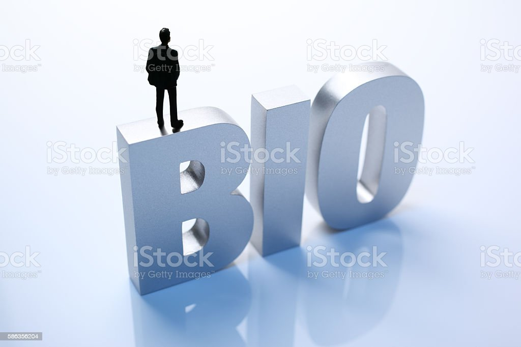 Figurine Businessman Standing on Big Letters BIO stock photo