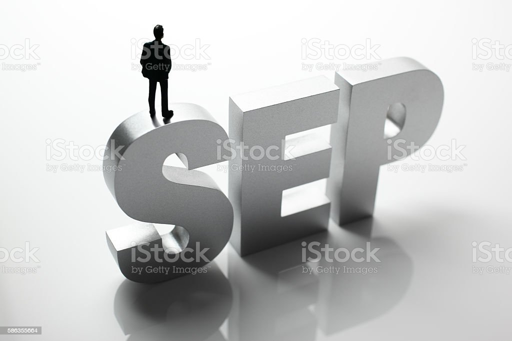 Figurine Businessman Standing on Big Letters SEP stock photo