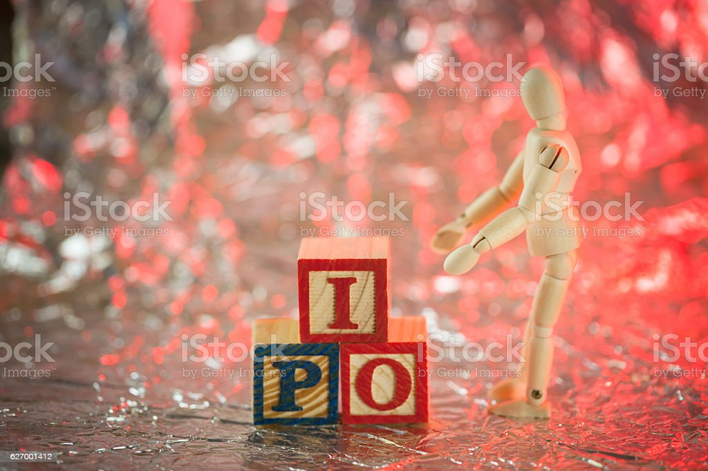 figurine concept moving IPO wooden cubic character stock photo