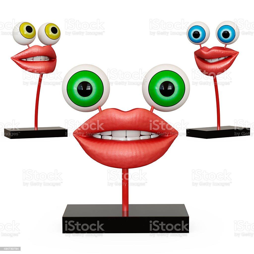 Figurine lips with eyes stock photo