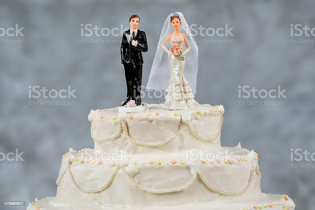 Figurines of the bride and groom on a wedding cake stock photo