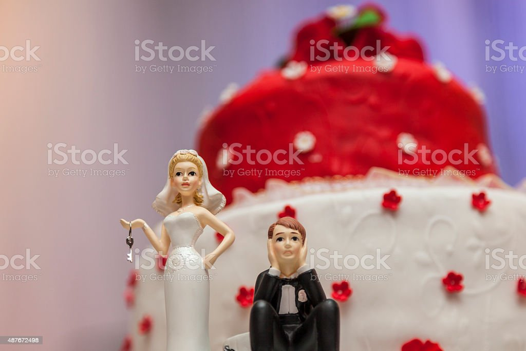 Figurines on bottom of wedding cake stock photo