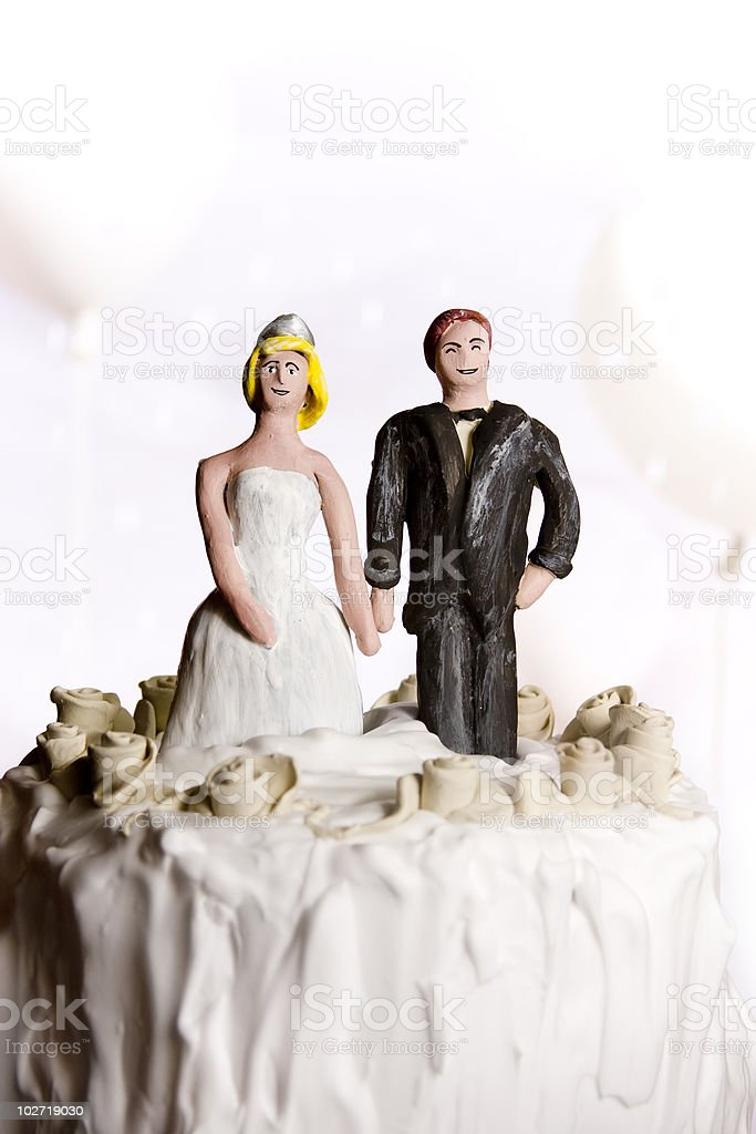 Figurines on top of wedding cake. Copy space royalty-free stock photo