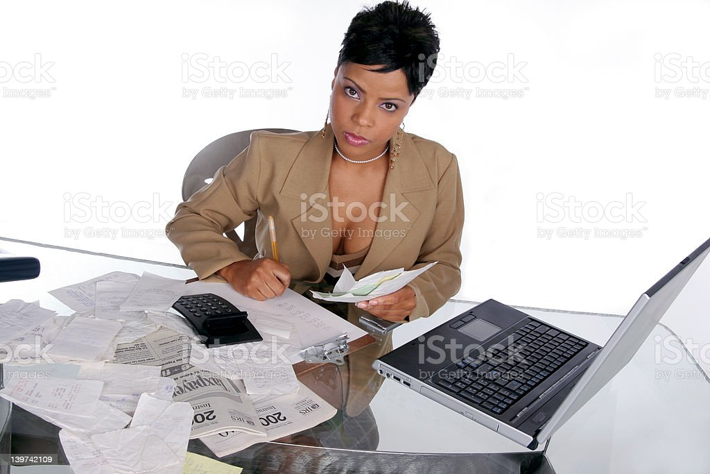 figuring out her taxes stock photo