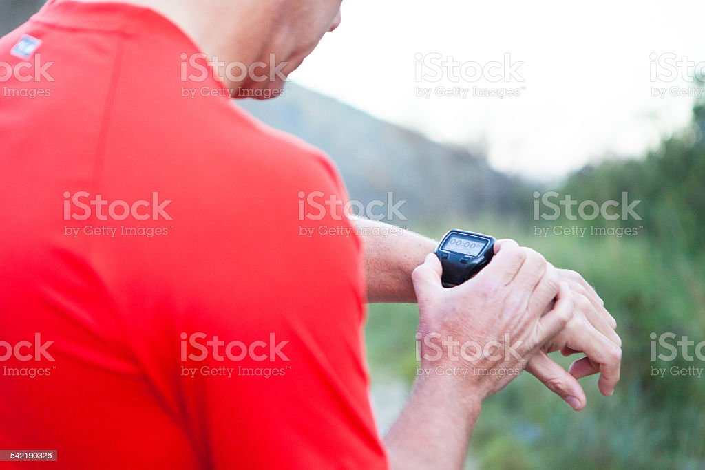 Figuring out how to use my new sports watch stock photo