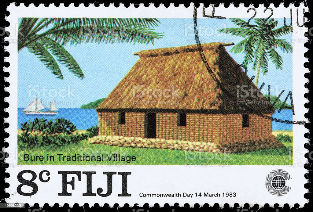 Fiji Bure in traditional village postage stamp stock photo
