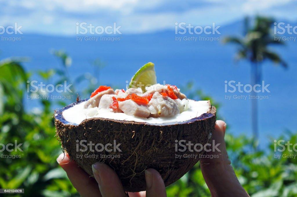 Fijian Food Kokoda  against Tropical Island landscape stock photo