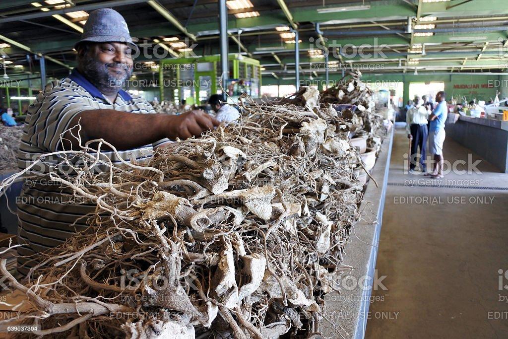 Fijian man sells Kava in a Market stock photo