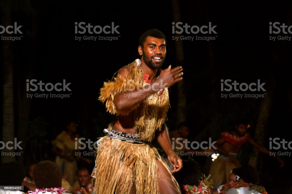 Fijian men dancing a traditional male dance meke wesi in Fiji stock photo