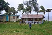 Fijian people run to Shelter in a Tropical Cyclone