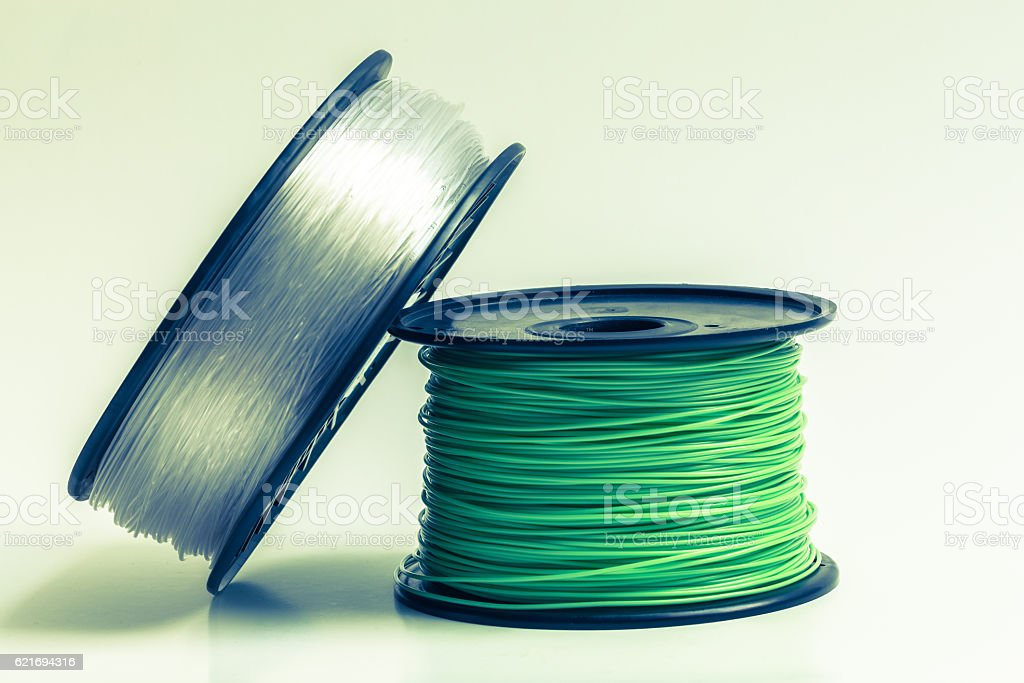 Filament for 3D Printer crystal clear and bright green stock photo
