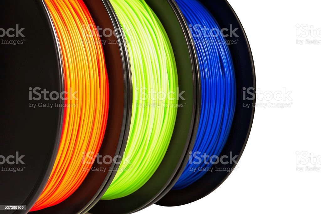 Filament for 3d printing. Orange, green, blue colors. Isolated, cutout. stock photo