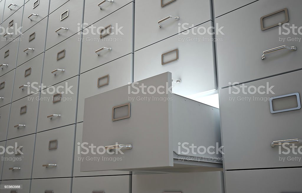 File cabinet with an open drawer royalty-free stock photo
