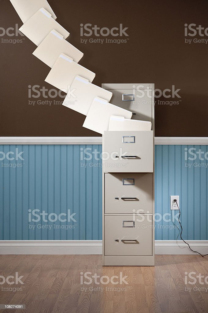 File Cabinet With Flying Folders. royalty-free stock photo