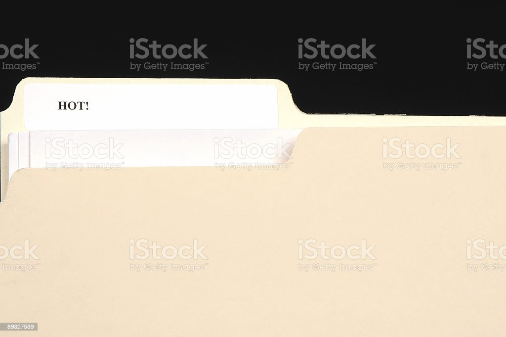 File folder with a white label stating HOT royalty-free stock photo