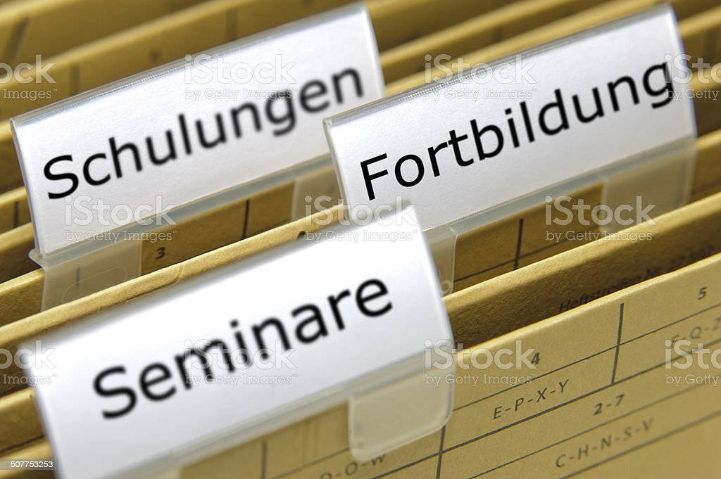 file folders marked with Seminar, Fortbildung stock photo