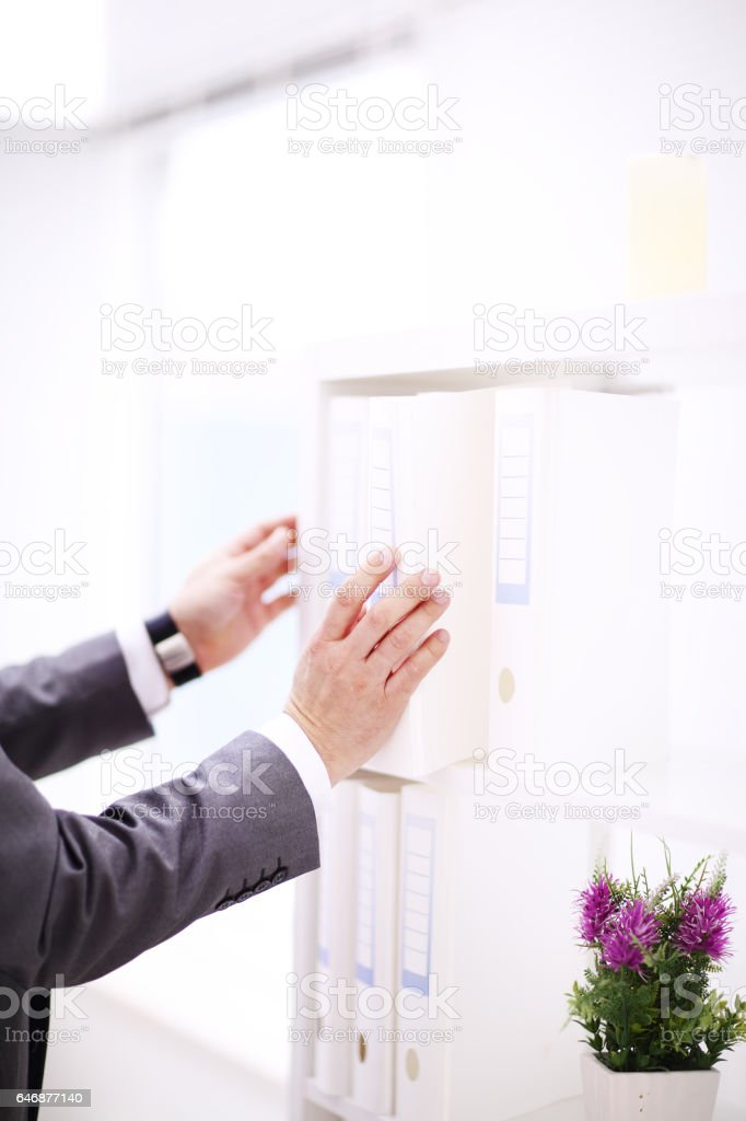 File folders, standing on shelves in the background stock photo