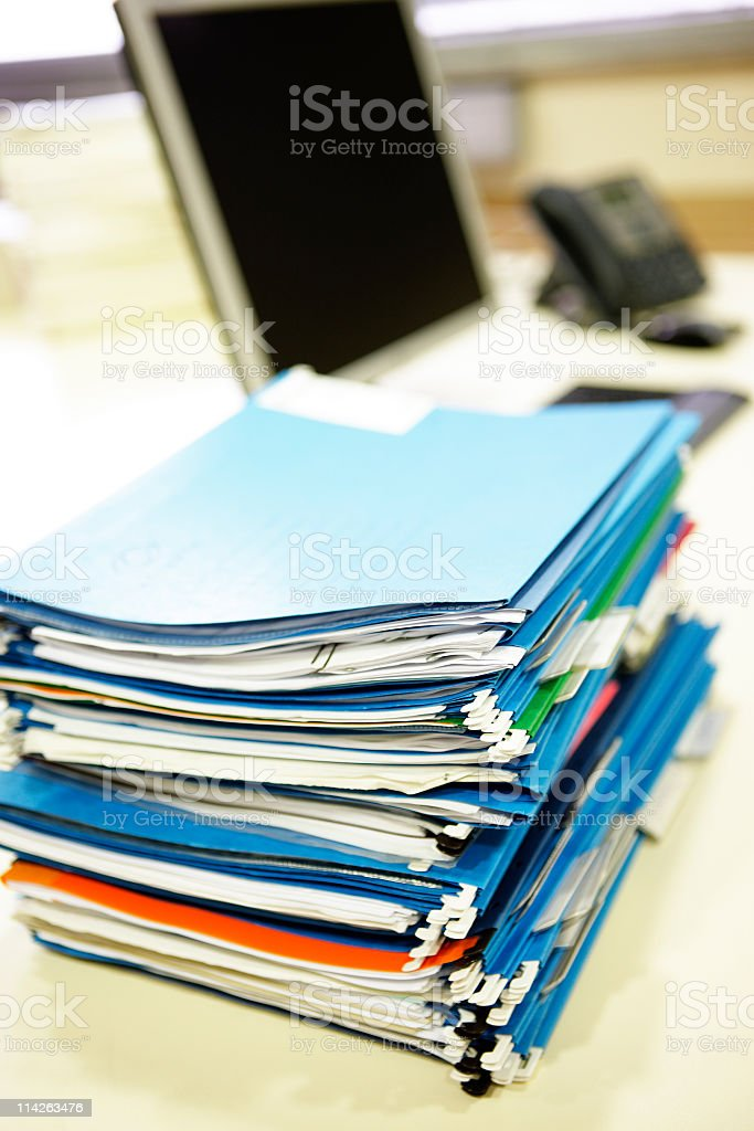 File folders with documents on an office desk royalty-free stock photo