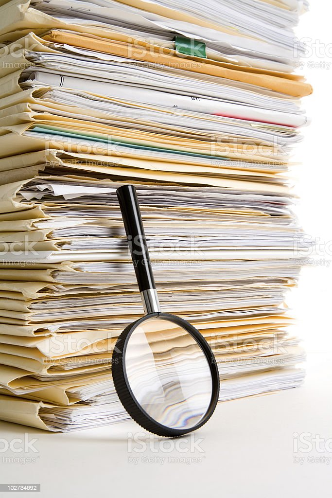 File Stack and Magnifying Glass royalty-free stock photo