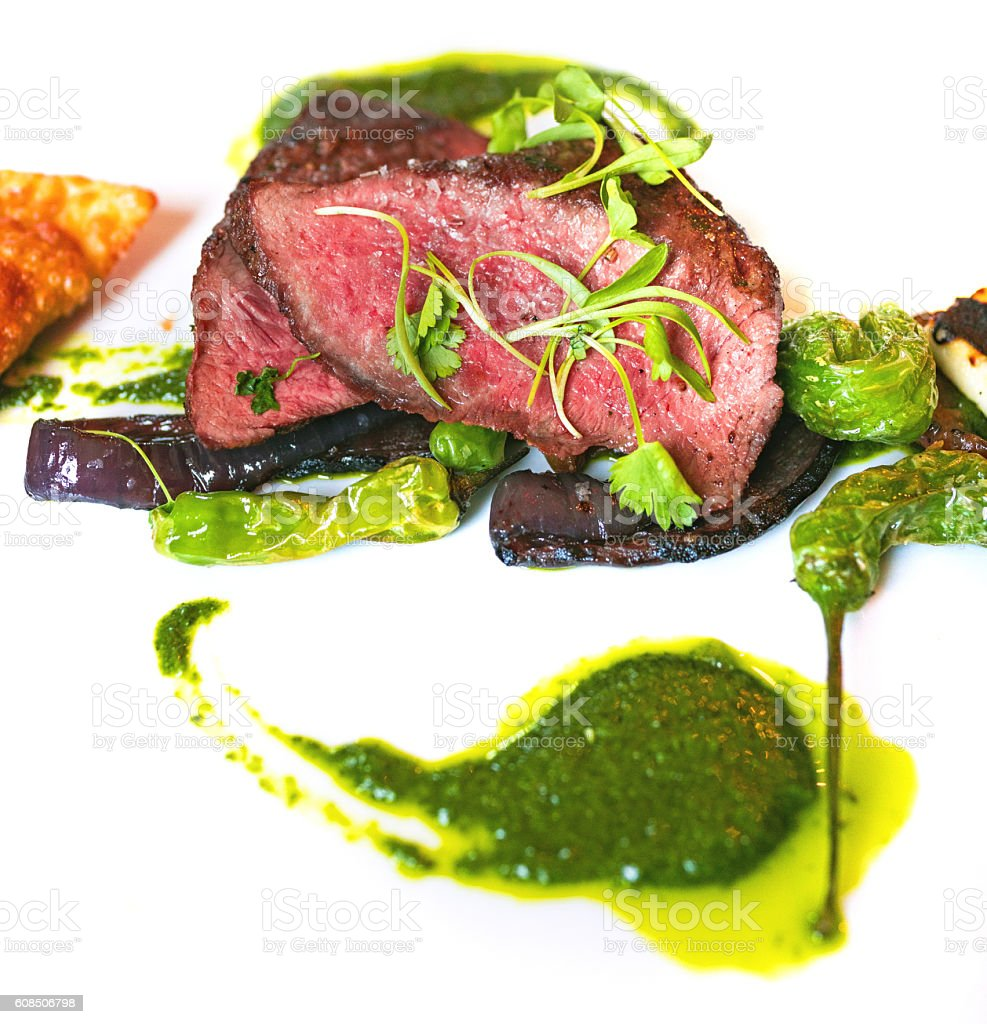 Filet mignon and green sauce stock photo