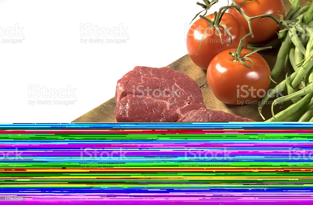 Filet mignon and vegetables on cutting board royalty-free stock photo