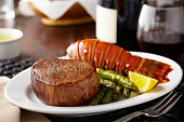 Filet mignon plated with asparagus and lobster tail