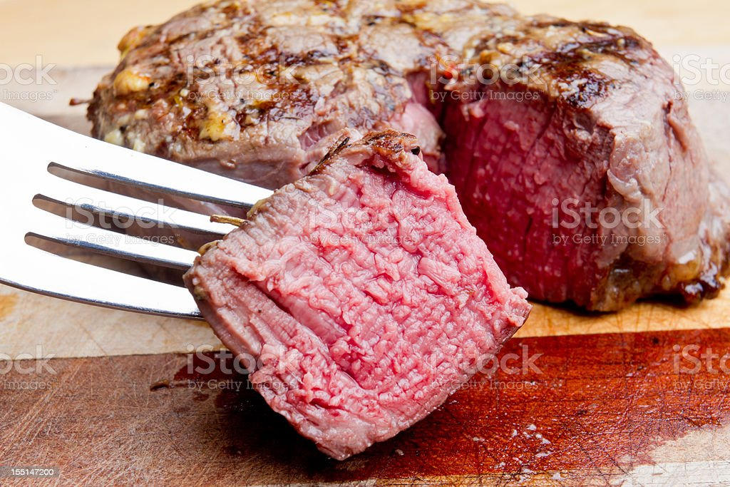 Filet Mignon Steak With Bite Cut Out stock photo