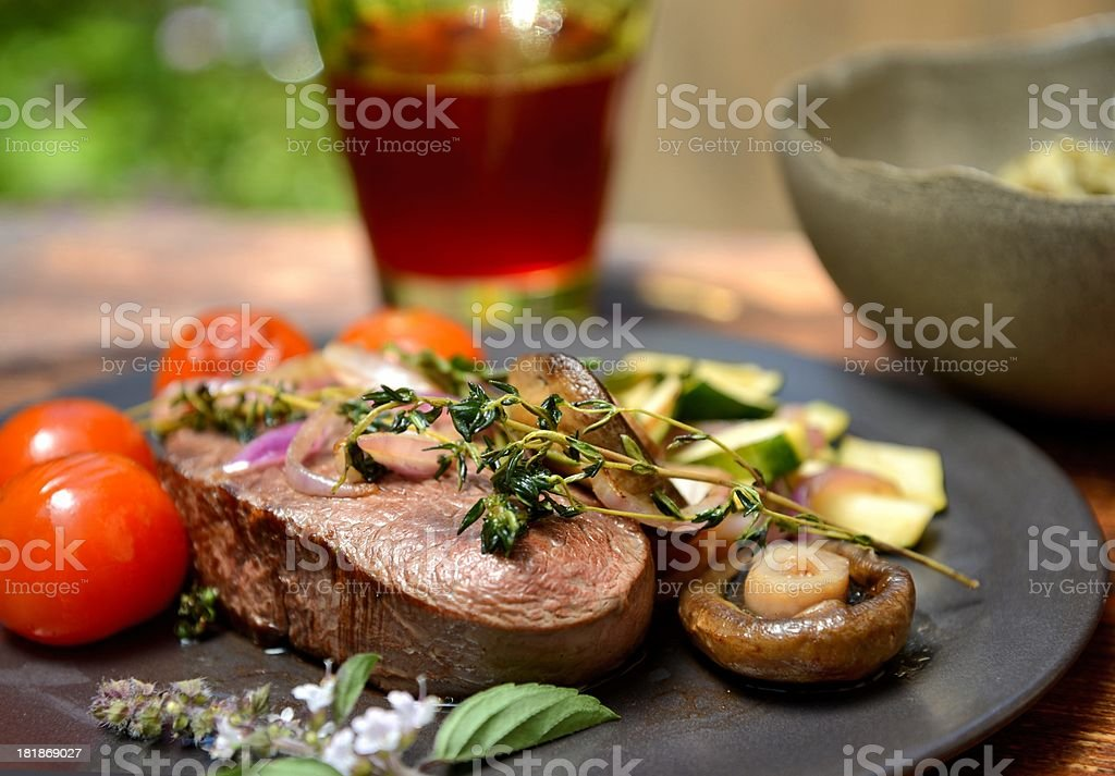 Filet Mignon Steak with herbs and vegetables royalty-free stock photo