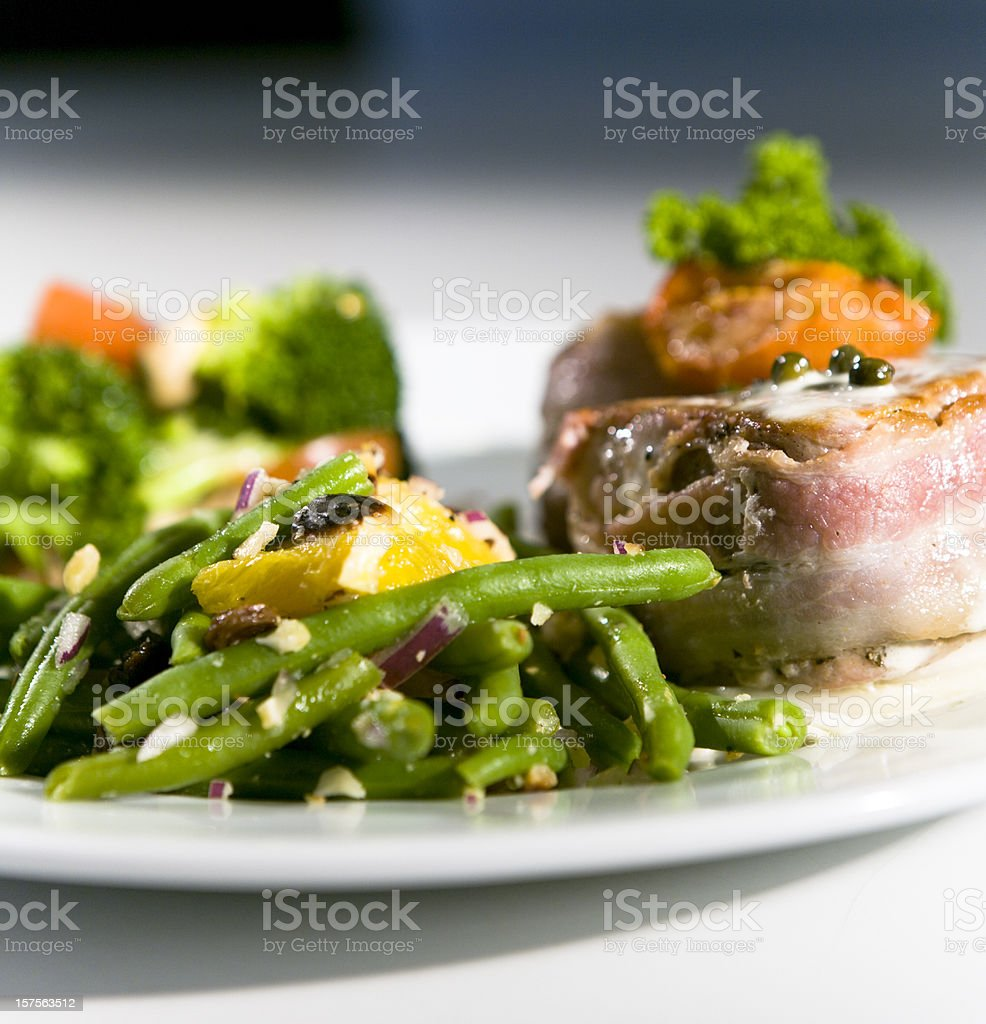 Filet Mignon w. Green Salads. royalty-free stock photo